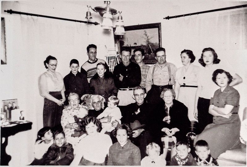 Back row:  Margie, Pete, Harold, Charlie, Roland, David, Russell, Thelma, Muriel, Peggy.  Middle row:  Gram & Gramp Grant, Uncle Winn, Aunt Grace.  Front row:  ___, Buddy, Nancy, Kathy, ___, ___, Lee.