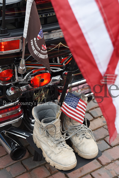 Harold Aughton/Butler Eagle: Robin Haas of New Castle carried a set of Army boots representing the fallen solider on back of his Harley during the Butler Veterans Day Parade.