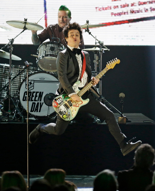 . Billie Joe Armstrong, front, and drummer Tre Cool, of Green Day, perform at the Rock and Roll Hall of Fame Induction Ceremony Saturday, April 18, 2015, in Cleveland. (AP Photo/Mark Duncan)