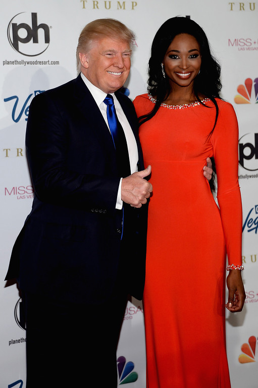 . Donald Trump (L) and Miss USA 2012 Nana Meriwether (R) arrive at the 2013 Miss USA pageant at Planet Hollywood Resort & Casino on June 16, 2013 in Las Vegas, Nevada.  (Photo by Ethan Miller/Getty Images)