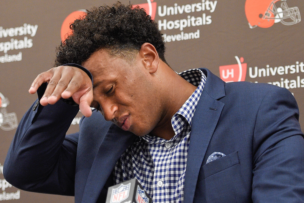 . Cleveland Browns quarterback DeShone Kizer wipes his forehead during a press conference after an NFL football game against the Baltimore Ravens in Baltimore, Sunday, Sept. 17, 2017. The Ravens defeated the Browns 24-10. (AP Photo/Nick Wass)