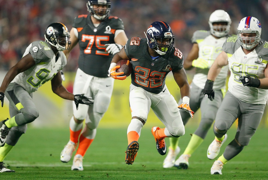 . GLENDALE, AZ - JANUARY 25: Team Irvin running back C.J. Anderson #22 of the Denver Broncos runs up field during the second half of the 2015 Pro Bowl at University of Phoenix Stadium on January 25, 2015 in Glendale, Arizona.  (Photo by Christian Petersen/Getty Images)