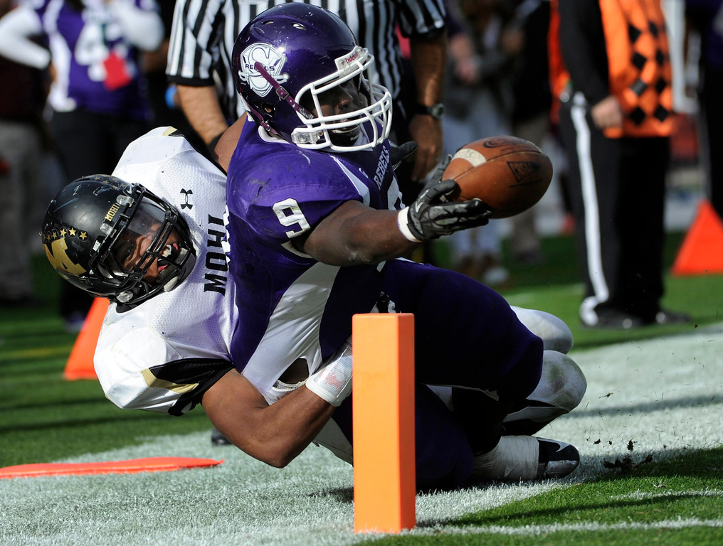 . Denver South\'s Trevonte Tasco (9) dives and reaches for at touchdown in the fourth quarter. Denver South High School takes on Monarch High School in the second half in the 4A Colorado State Football Championships at Sports Authority Field at MIle High in Denver on Saturday, Dec. 1, 2012.