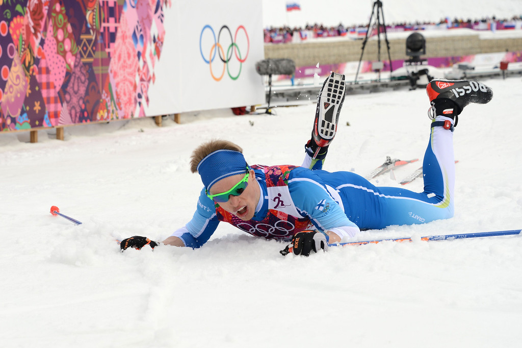 . Finland\'s Iivo Niskanen lies on the snow at the finish line of the Men\'s Cross-Country Skiing 15km Classic at the Laura Cross-Country Ski and Biathlon Center during the Sochi Winter Olympics on February 14, 2014 in Rosa Khutor near Sochi. AFP PHOTO / KIRILL  KUDRYAVTSEV/AFP/Getty Images