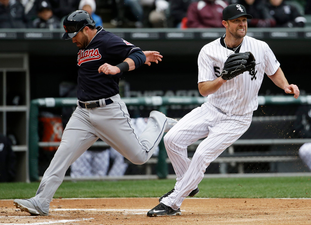 . Cleveland Indians\' Jason Kipnis, left, scores as Chicago White Sox starter John Danks waits for the ball during the first inning of a baseball game Friday, April 8, 2016, in Chicago. (AP Photo/Nam Y. Huh)