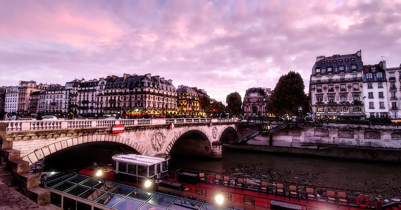 Pont Saint-Michel bridge on the Seine river in Paris at sunset.  Watercolor processing.
