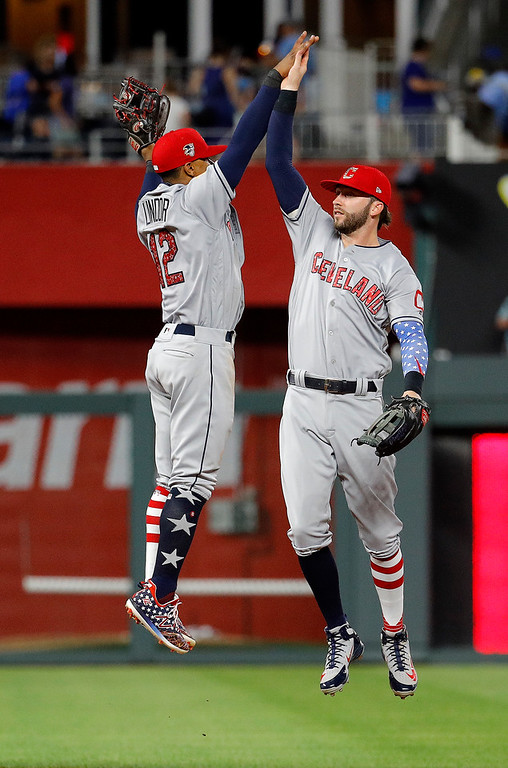 . Cleveland Indians\' Francisco Lindor (12) and Tyler Naquin celebrate after the team\'s 6-4 win in a baseball game against the Kansas City Royals Tuesday, July 3, 2018, in Kansas City, Mo.  (AP Photo/Charlie Riedel)