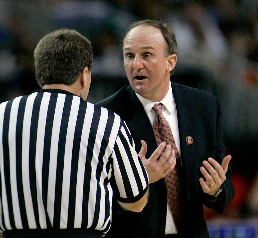. Ohio State coach Thad Matta talks with an official in the first half in the  men\'s championship basketball game at the Final Four in the Georgia Dome in Atlanta Monday, April 2, 2007. (AP Photo/Gerry Broome)