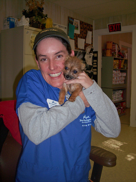 Kristin Kifer snuggling Snuffalupagus (now Termite) in the office at 1430