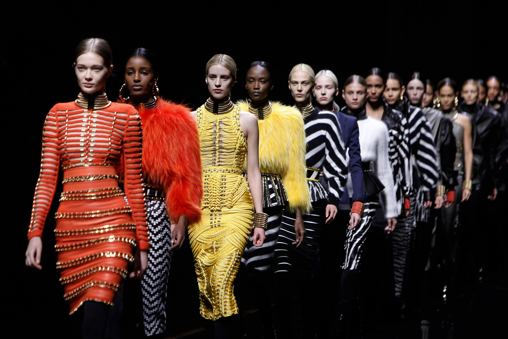 . Models wear creations for Balmain\'s ready-to-wear fall/winter 2014-2015 fashion collection, presented in Paris, Thursday, Feb.27, 2014. (AP Photo/Thibault Camus)