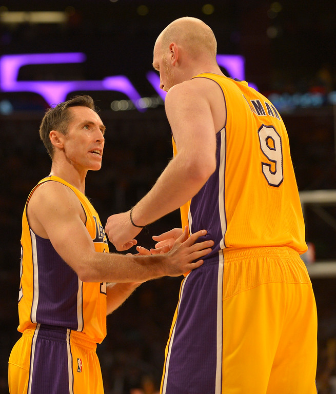 . Lakers Steve Nash and Chris Kaman celebrate in the 4th quarter. The Los Angeles Lakers defeated the Clippers 116 to 103 in the opening game of the season at Staples Center. Los Angeles, CA. 10/29/2013. photo by (John McCoy/Los Angeles Daily News)