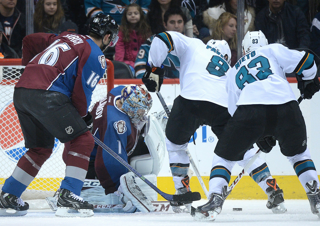 . DENVER, CO. - JANUARY 04:  Sharks\' center Joe Pavelski (8) pressured Colorado goaltender Semyon Varlamov (1) in the third period. The Colorado Avalanche defeated the San Jose Sharks 4-3 at the Pepsi Center Saturday afternoon, January 4, 2014. Photo By Karl Gehring/The Denver Post