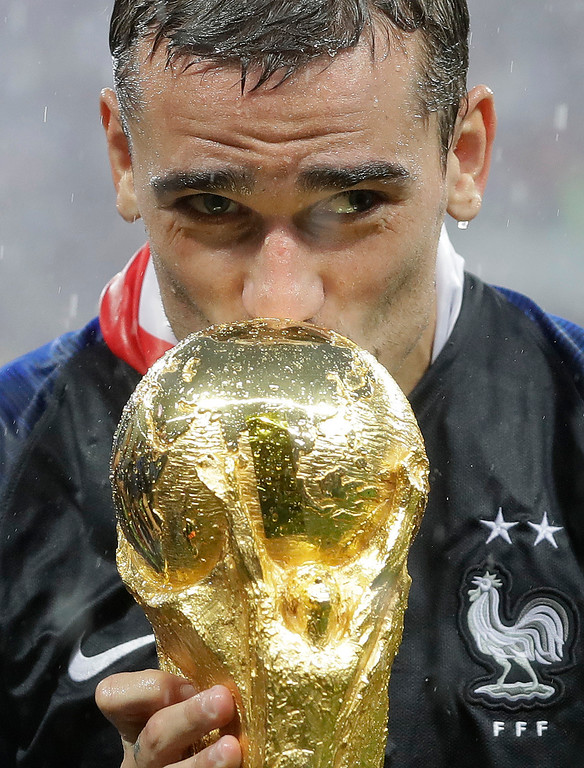 . France\'s Antoine Griezmann kisses the trophy after the final match between France and Croatia at the 2018 soccer World Cup in the Luzhniki Stadium in Moscow, Russia, Sunday, July 15, 2018. France won the final 4-2. (AP Photo/Matthias Schrader)