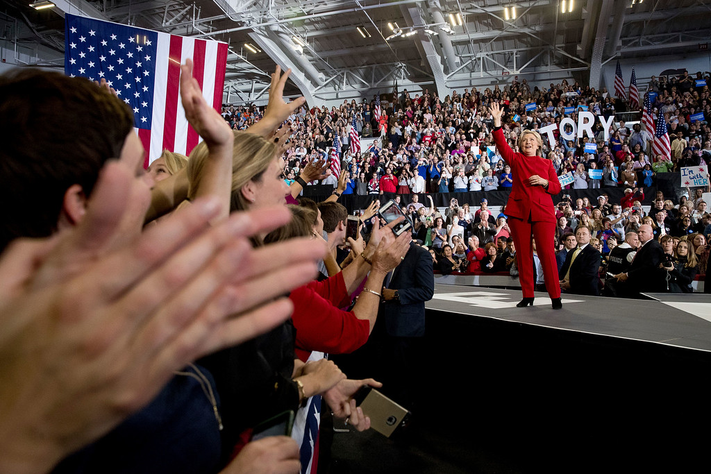 . Democratic presidential candidate Hillary Clinton waves after speaking at a midnight rally at Reynolds Coliseum at North Carolina State University in Raleigh, N.C., Tuesday, Nov. 8, 2016. (AP Photo/Andrew Harnik)