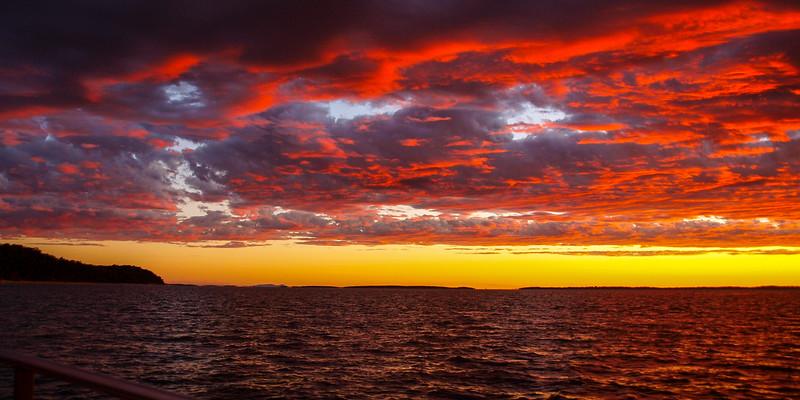A brilliant Red, Crimson, sunrise seascape,