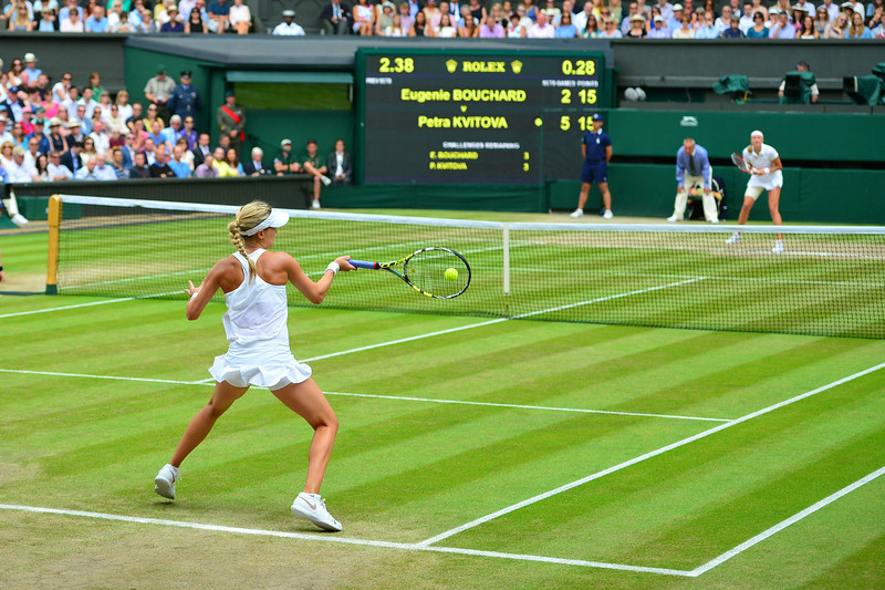. Canada\'s Eugenie Bouchard returns to Czech Republic\'s Petra Kvitova during their women\'s singles final match on day twelve of  the 2014 Wimbledon Championships at The All England Tennis Club in Wimbledon, southwest London, on July 5, 2014. Kvitova stormed to her second Wimbledon title in the shortest women\'s final since 1983 as the Czech sixth seed crushed Canada\'s Eugenie Bouchard 6-3, 6-0. (CARL COURT/AFP/Getty Images)