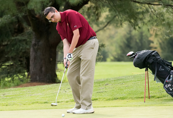 05/10/18 Wesley Bunnell | Staff New Britain golf defeated Bristol Eastern 212-219 at Stanley Golf Course on Thursday afternoon. New Britain's Arthur Bell watches as his putt heads towards the hole.