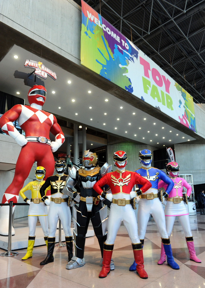. Saban\'s Power Rangers Megaforce strike a pose with the giant Mighty Morphin Power Ranger on display at the American International Toy Fair, Sunday, Feb. 10, 2013, in New York. (Diane Bondareff/Invision for Saban Brands/AP Images)