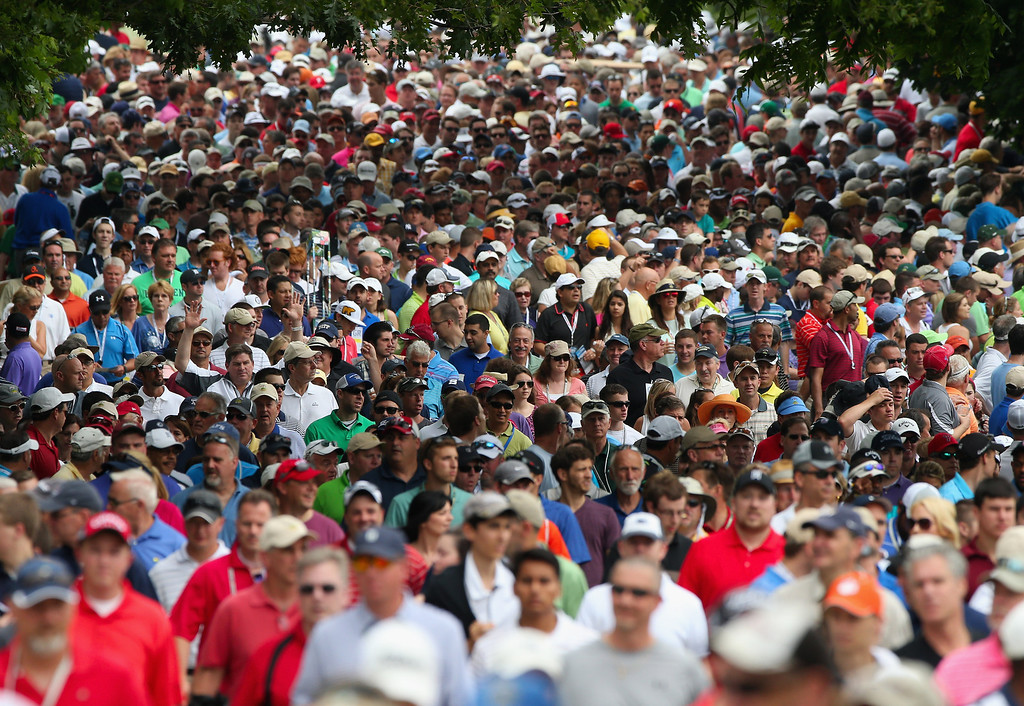 . ARDMORE, PA - JUNE 16:  A gallery of patrons follow Tiger Woods of the United States and Matt Bettencourt of the United States near the second hole during the final round of the 113th U.S. Open at Merion Golf Club on June 16, 2013 in Ardmore, Pennsylvania.  (Photo by Andrew Redington/Getty Images)