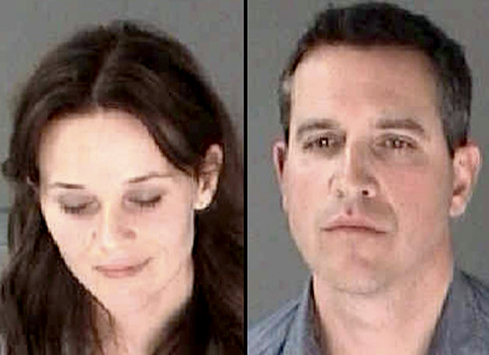 . This combination of booking photos provided April 22, 2013 by the Georgia Department of Corrections shows US actress Reese Witherspon(L) and her husband Jim Toth, who were arrested early April 19, and briefly jailed. The couple were pulled over under the suspicion of driving under the influence(DUI). Toth was arrested for a DUI and Witherspoon was hit with a disorderly conduct charge for failure to obey a police officer.    AFP PHOTO / Georgia Department of Corrections