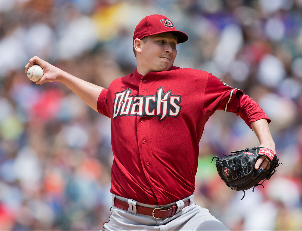 . Starting pitcher Trevor Cahill #35 of the Arizona Diamondbacks delivers to home plate during the third inning against the Colorado Rockies at Coors Field on May 22, 2013 in Denver, Colorado. The Rockies defeated the Diamondbacks 4-1.  (Photo by Justin Edmonds/Getty Images)