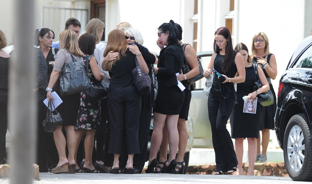 ". Relatives and friends of the late South African model Reeva Steenkamp gather for the funeral ceremony at the crematorium building in Port Elizabeth on February 19, 2013 after Steenkamp, 29, was shot four times in the early hours of February 14, 2013 by a 9mm pistol owned by South African sporting hero Oscar Pistorius. South African prosecutors on Tuesday told a bail hearing that Oscar Pistorius was guilty of ""premeditated murder\"" in the Valentine\'s Day killing of his model girlfriend at his upscale home.  ALEXANDER JOE/AFP/Getty Images"