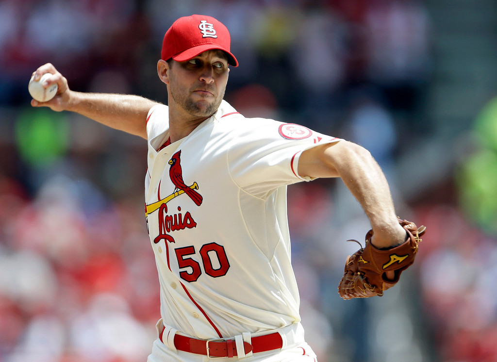 . St. Louis Cardinals starting pitcher Adam Wainwright throws during the first inning of a baseball game against the Colorado Rockies, Saturday, May 11, 2013, in St. Louis. (AP Photo/Jeff Roberson)