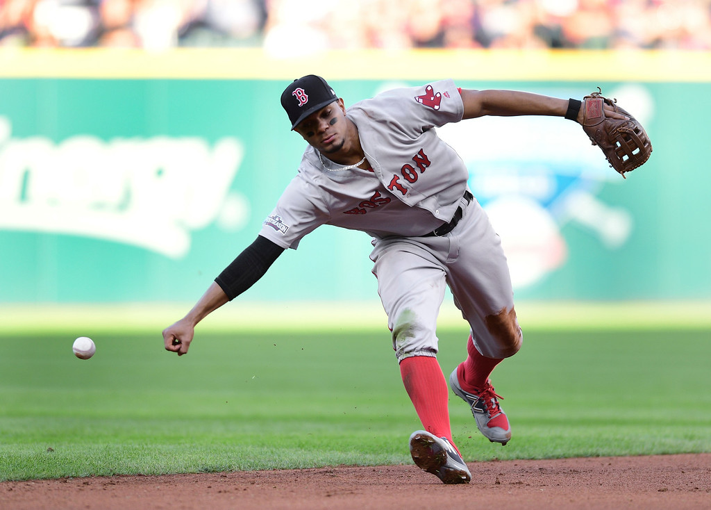 . Boston Red Sox shortstop Xander Bogaerts cannot handle a Cleveland Indians\' Brandon Guyer ground ball in the inning during Game 2 of baseball\'s American League Division Series, Friday, Oct. 7, 2016, in Cleveland. (AP Photo/David Dermer)