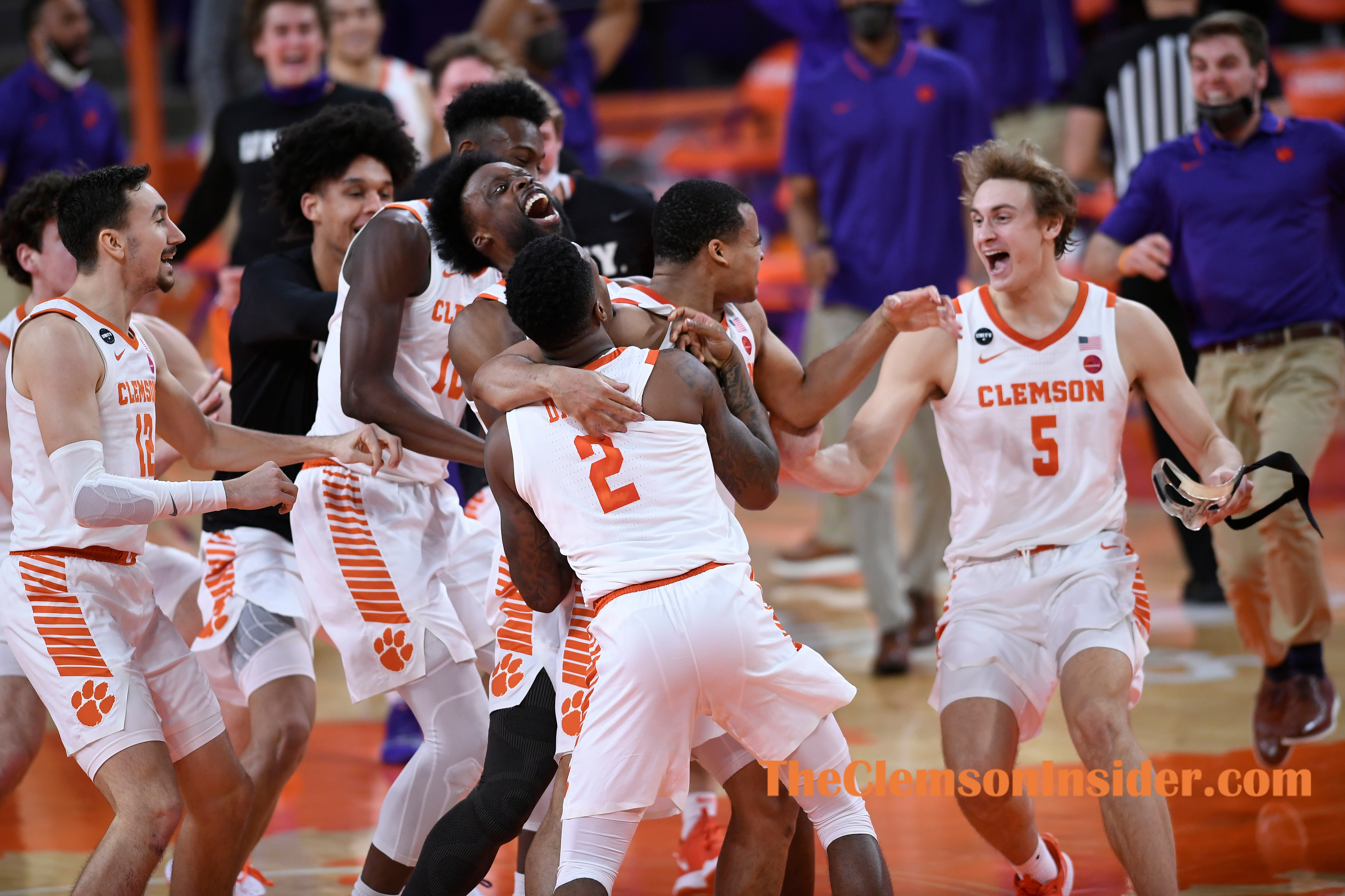 Clemson guard Nick Honor (4) celebrates teammates after sinking the game winning three point basket against Georgia Tech at Clemson's Littlejohn Coliseum Saturday, February 12, 2021. ACC Pool/Bart Boatwright/The Clemson Insider