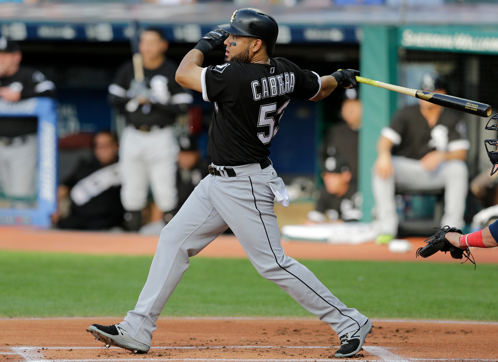 . Chicago White Sox\'s Melky Cabrera hits a single off Cleveland Indians starting pitcher Josh Tomlin in the first inning of a baseball game, Saturday, June 10, 2017, in Cleveland. (AP Photo/Tony Dejak)