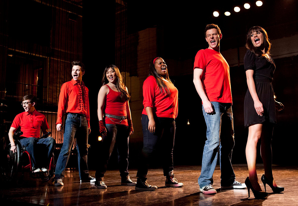 """. In this image released by Fox, cast members, from left, Kevin McHale, Chris Colfer, Jenna Ushkowitz, Amber Riley, Cory Monteith and Lea Michele perform during a scene from \""""Glee.\""""  Monteith was found dead in a Vancouver hotel room, police said. He was 31. (AP Photo/Fox, Adam Rose)"""