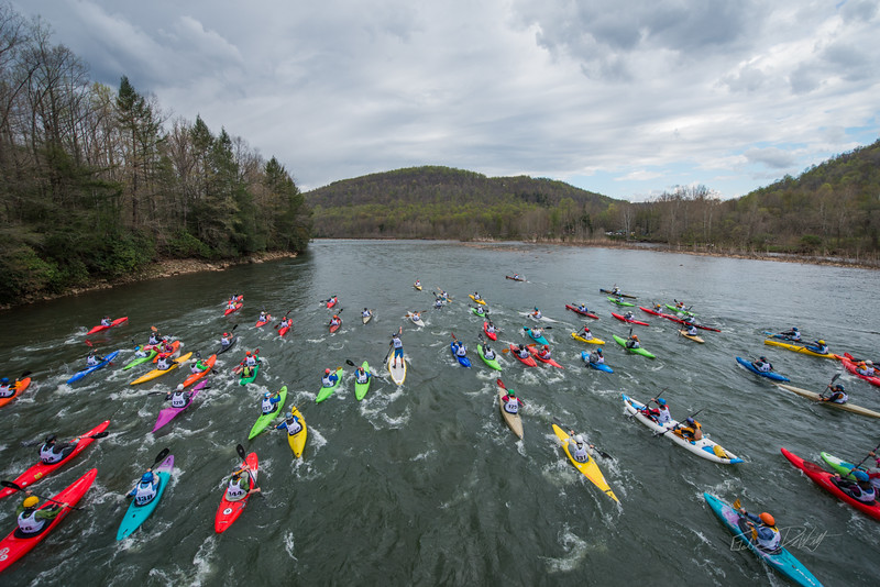 NCM15010; 150501; 2456; Allegheny Trail; Cheat Fest; Cheat River; Cheat River Festival; Events; Friends of the Cheat; Gabe DeWitt; TNC; The Nature Conservancy; The Nature Conservancy Magazine; West Virginia; photo by Gabe DeWitt; spring The Down River Race. The mass start of the race, seen from the old bridge that extends half way across the river.