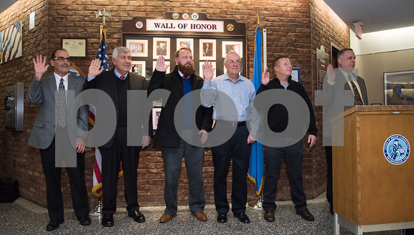 11/21/17 Wesley Bunnell | Staff Berlin held their Swearing-In Ceremony for elected officials at Berlin Town Hall on Tuesday evening. Board of Finance members with their hands raised being sworn in. Sal Bordonaro, Sam Lomaglio, Kevin Guite, Gerald P. Paradis, Mark Holmes & John Richards.