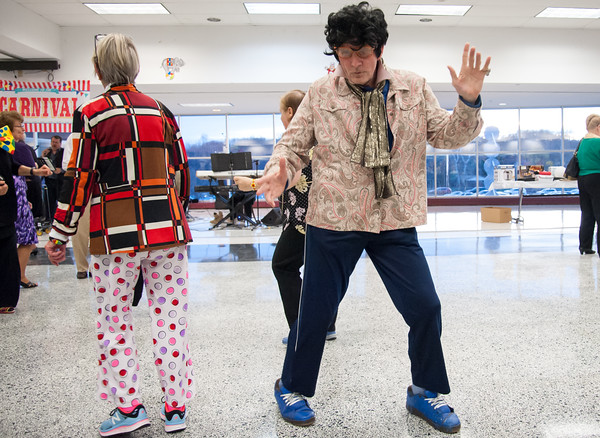 04/19/18 Wesley Bunnell | Staff Don Cmuchowski known as New Britain's Elvis dances Thursday night at TRIAD's 20th annual senior prom held at New Britain High School which featured a carnival theme.