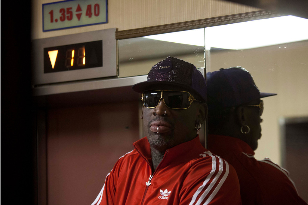 . Dennis Rodman waits for the elevator as he arrives at his hotel in Pyongyang, North Korea after a morning practice session on Wednesday, Jan. 8, 2014. Rodman came to the North Korean capital with a team of USA basketball stars for an exhibition game on Jan. 8, the birthday of North Korean leader Kim Jong Un. (AP Photo/David Guttenfelder)