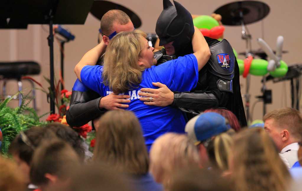 . John Buckman, dressed as Batman, hugs the aunt of Jacob Hall, Rebecca Hunnicut, after speaking during the superhero-themed funeral service for Jacob  at Oakdale Baptist Church on Wednesday, Oct. 5, 2016, in Townville, S.C.  Jacob\'s family has encouraged people to celebrate his life by dressing as the superheroes he loved.  A 14-year-old boy killed his own father, then drove to Townville Elementary and fired on two children and a teacher as recess began.  Jacob died Saturday.  ( Ken Ruinard/The Independent-Mail via AP, Pool)