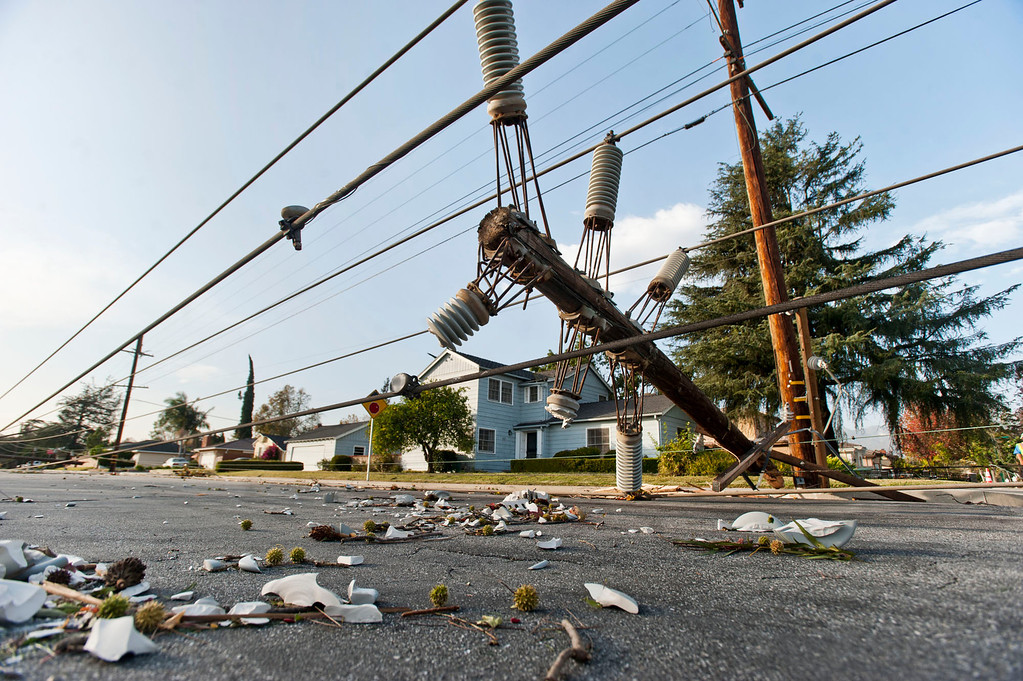 . More than a dozen of power polls knocked over in the 9900 block of Live Oak Ave. in Temple City on Thursday, Dec. 1, 2011. Winds gusting up to 80 miles an hour whipped through the west San Gabriel Valley overnight causing trees to snap and power lines to fall. (SGVN/Staff photo by Watchara Phomicinda/SVCity)