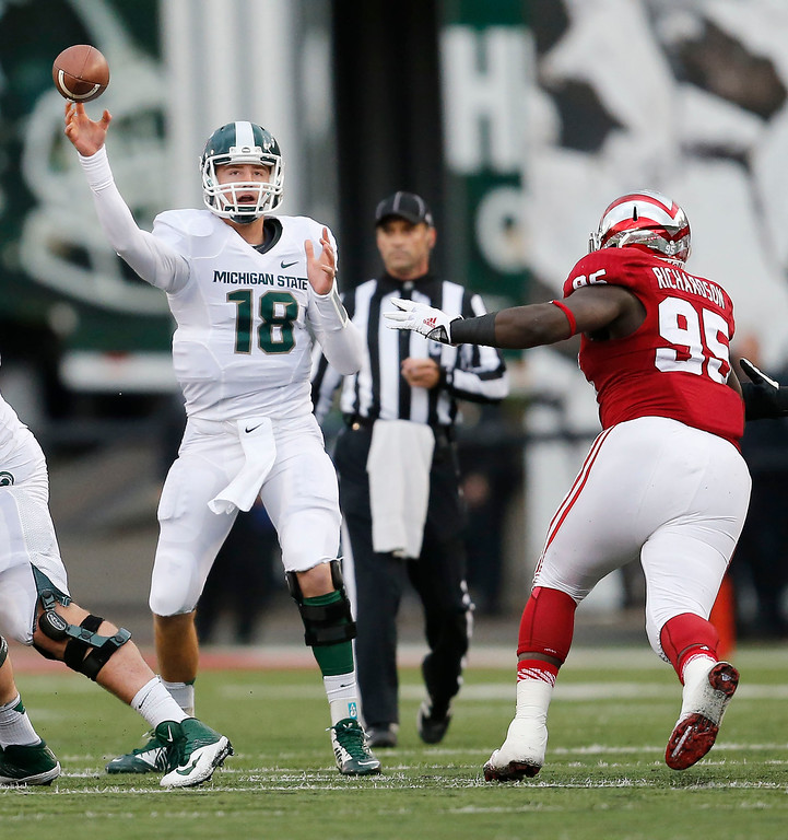 . Michigan State quarterback Connor Cook (18) throws against Indiana�s Bobby Richardson (95) during the first half of a NCAA college football game, Saturday, Oct. 18, 2014 in Bloomington, Ind. (AP Photo/Sam Riche)