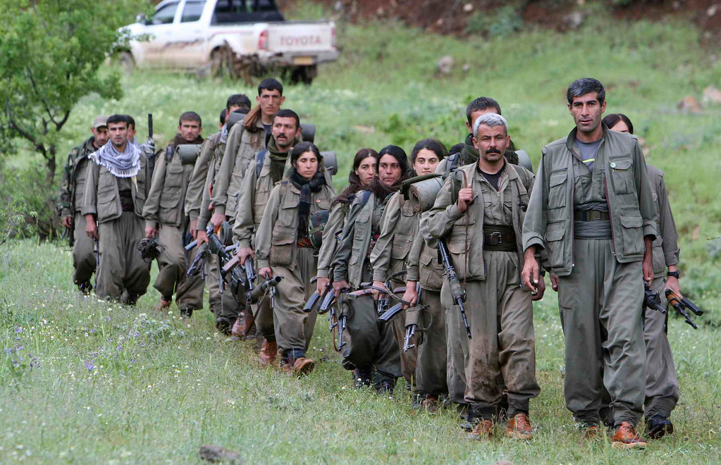 . Kurdistan Workers Party (PKK) fighters walk on the way to their new base in northern Iraq May 14, 2013. The first group of Kurdish militants to withdraw from Turkey under a peace process entered northern Iraq on Tuesday, and were greeted by comrades from the Kurdistan Workers Party (PKK), in a symbolic step towards ending a three-decades-old insurgency. The 13 men and women, carrying guns and with rucksacks on their backs, arrived in the area of Heror, near Metina mountain on the Turkish-Iraqi border, a Reuters witness said. REUTERS/Azad Lashkari