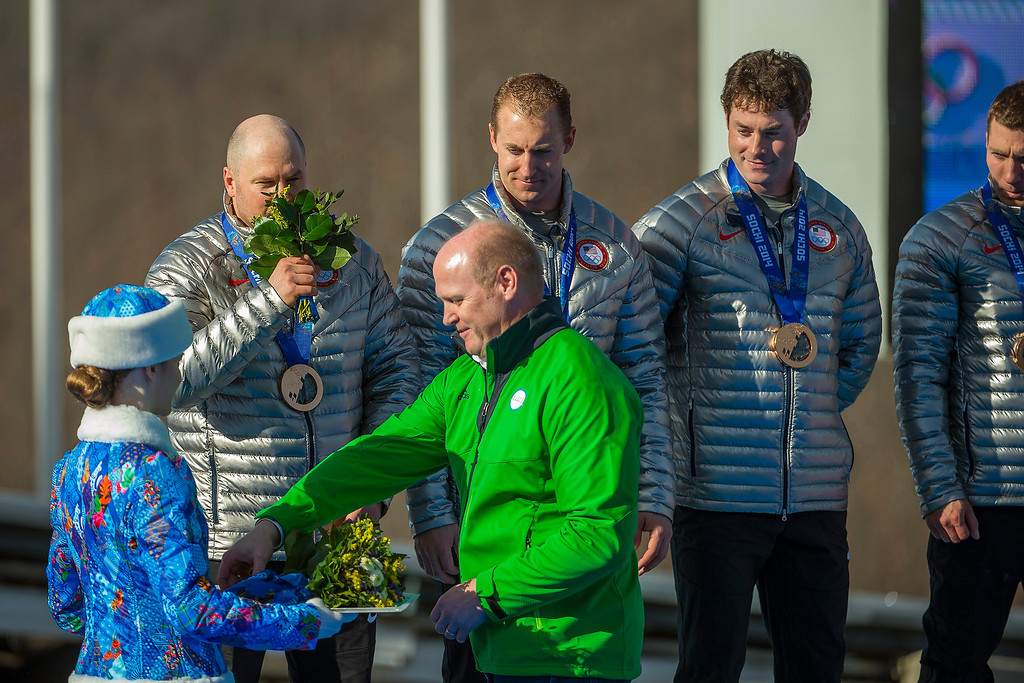 . USA\'s Steven Holcomb, Chris Fogt, Curtis Tomasevicz, and Steve Langton, celebrate during the medal ceremony at the finish of the four-man bobsled at Sanki Sliding Center during the 2014 Sochi Olympics Sunday February 23, 2014. They won the bronze medal with a cumulative time of 3:40.99.  (Photo by Chris Detrick/The Salt Lake Tribune)