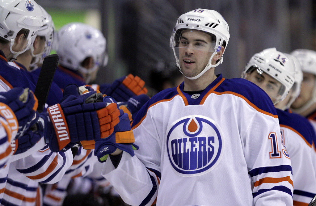 . Edmonton Oilers players congratulate Edmonton Oilers center Jordan Eberle (14) after his goal against the Colorado Avalanche in the first period of an NHL game on Friday, April 19, 2013, in Denver. (AP Photo/Joe Mahoney)