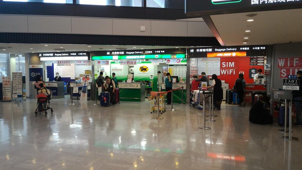 Takkyubin counters in arrival hall