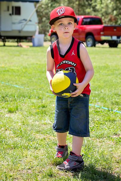 Jayden posing with ball.jpg