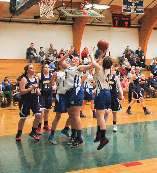 Madison Frazier grabs the rebound against Bucksport. Photo by Jack Scott