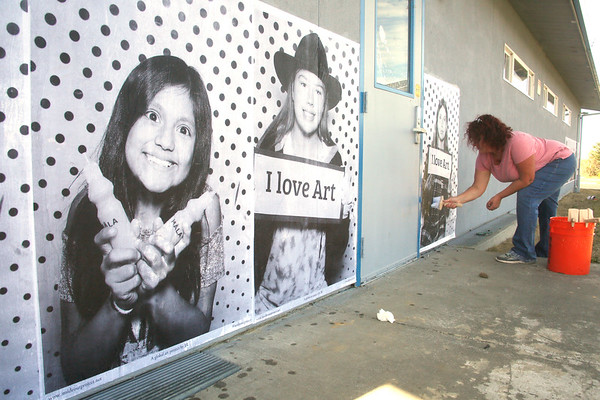 Photos: Giant portrait mural project at South Bay School