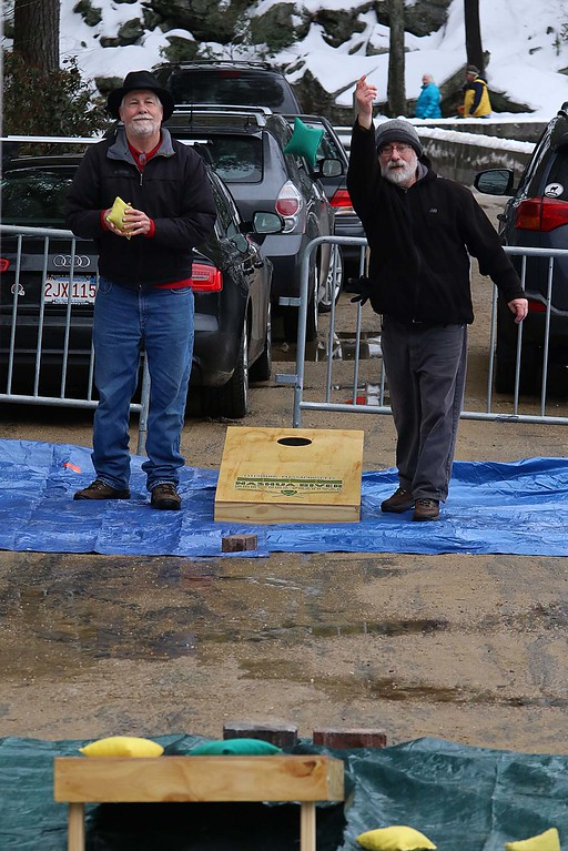 . Playing some cornhole at the Fitchburg Winterfest at Coggshall Park Jon Giannetti, on right, and David Streb. SENTINEL & ENTERPRISE/JOHN LOVE