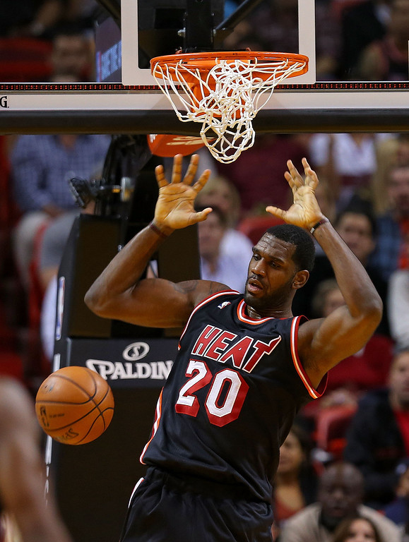 . Greg Oden #20 of the Miami Heat dunks during a game against the Los Angeles Lakers at American Airlines Arena on January 23, 2014 in Miami, Florida.  (Photo by Mike Ehrmann/Getty Images)