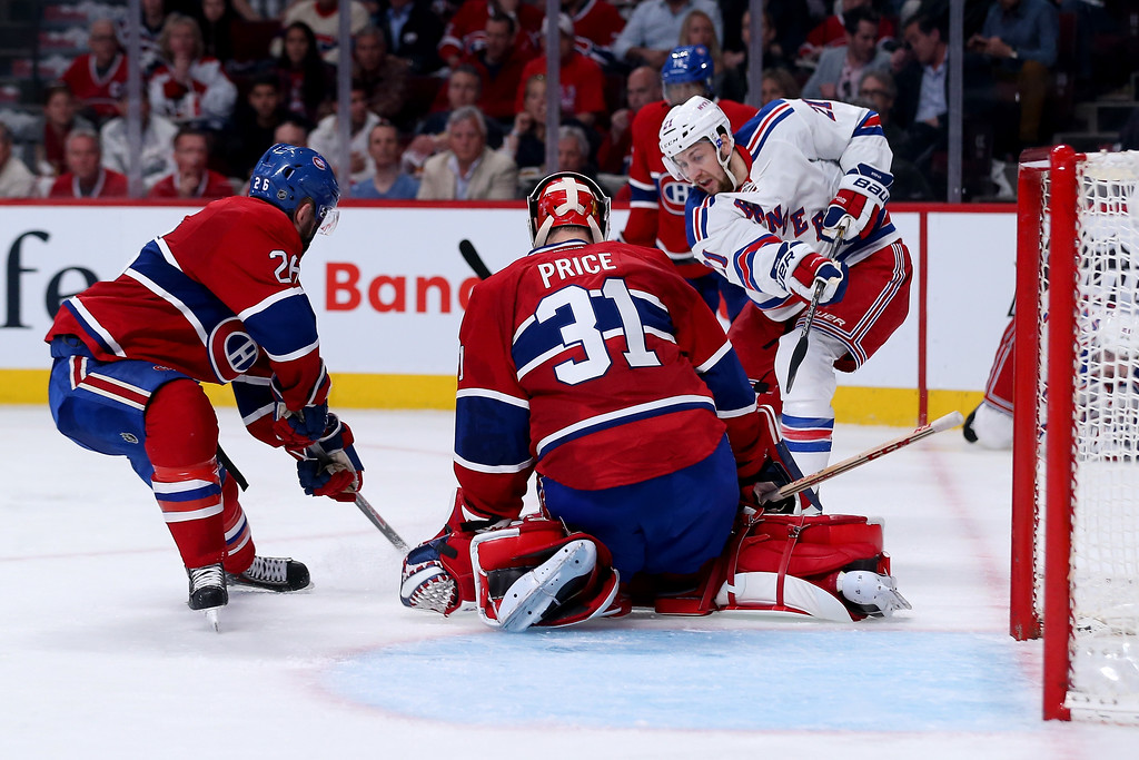 . MONTREAL, QC - MAY 17:  Goaltender Carey Price #31 of the Montreal Canadiens makes a save on Derek Stepan #21 of the New York Rangers in the second period in Game One of the Eastern Conference Finals of the 2014 NHL Stanley Cup Playoffs at the Bell Centre on May 17, 2014 in Montreal, Canada.  (Photo by Bruce Bennett/Getty Images)
