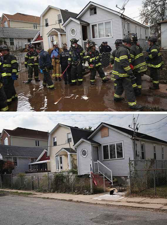 . NEW YORK, NY - NOVEMBER 02: (top)  Firemen gather outside a house where the bodies of two elderly people were reportedly found on November 2, 2012 in the Midland Beach section of the Staten Island borough of New York City. NEW YORK, NY - OCTOBER 17:  (bottom)  A cat sits outside a home on October 17, 2013 in the Midland Beach section of the Staten Island borough of New York City. Hurricane Sandy made landfall on October 29, 2012 near Brigantine, New Jersey and affected 24 states from Florida to Maine and cost the country an estimated $65 billion.  (Photos by John Moore/Getty Images)