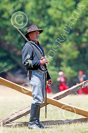 Pictures of Historical Re-Enactors of Mixed Yankees and Rebels in Civil War Battle Scenes